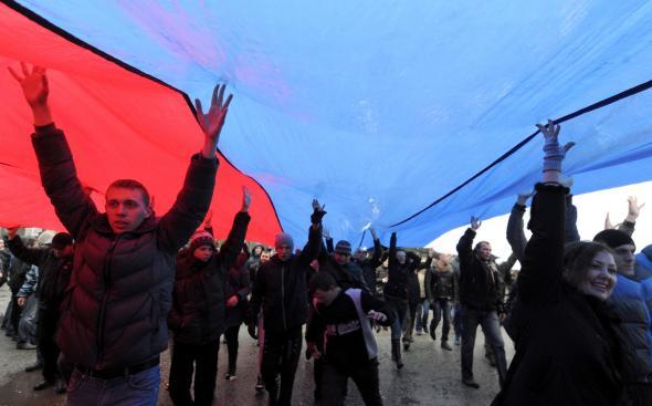 475280775-pro-russian-demonstrators-carry-a-giant-russian-flag-as.jpg.CROP.promovar-mediumlarge